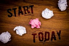 Handwriting text Start Today. Concept meaning Initiate Begin right now Inspirational Motivational phraseIdeas words wooden backgro. Handwriting texts Start Today stock photo