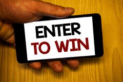 Handwriting text writing Enter To Win. Concept meaning Award Reward Prize given for visiting a website Chance Giveaway. Handwriting texts writing Enter To Win stock photography