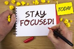 Handwriting text writing Stay Focused Motivational Call. Concept meaning Maintain Focus Inspirational Thinking. Handwriting texts writing Stay Focused stock photo