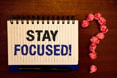 Handwriting text writing Stay Focused Motivational Call. Concept meaning Maintain Focus Inspirational Thinking. Handwriting textss writing Stay Focused stock photo