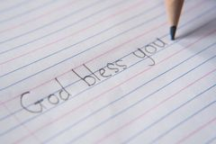 Handwriting używać ołówek na papierze zdjęcia royalty free