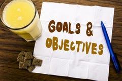 Handwriting zawiadomienia tekst pokazuje celów cele Biznesowy pojęcie dla planu sukcesu wzroku pisać na tkankowym papierze na wo Zdjęcie Royalty Free