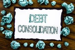 Handwriting zawiadomienia tekst pokazuje dług konsolidację Biznesowy pojęcie dla pieniądze pożyczki kredyta Pisać na kleistym nut obraz royalty free