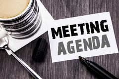 Handwriting zawiadomienia tekst pokazuje spotkanie agendę Biznesowy pojęcie dla Biznesowego rozkładu planu pisać na kleistym nuto Zdjęcia Stock