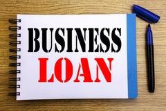 Handwriting zawiadomienia teksta seansu Biznesowa pożyczka Biznesowy pojęcie dla Pożyczać finanse kredyt Pisać na notepad nutoweg obrazy stock