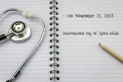 Handwritten on an agenda international Day of Spina bifida. Conceptual image stock photo
