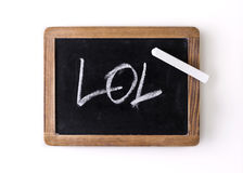 Handwritten on a blackboard: LOL (laughing out loud) Royalty Free Stock Photo