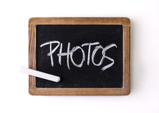 Handwritten on a blackboard: photos Royalty Free Stock Images