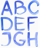 Handwritten blue watercolor alphabet Royalty Free Stock Photography