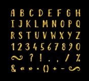 Handwritten font with punctuation marks. Handwritten bold gold font with punctuation marks on black background. Uppercase font contains question mark Stock Image