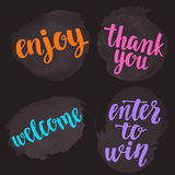 Handwritten brush calligraphy catchwords. Welcome, enjoy, thank you, enter to win. Royalty Free Stock Photos