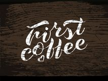 Hand lettering First coffee on wood. Handwritten brush lettering First coffee. shabby inscription on background of the texture of a wooden board. Vector Royalty Free Stock Images