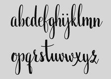 Handwritten brush style calligraphy cursive font. Handwritten brush style modern calligraphy cursive font. Calligraphy alphabet. Cute calligraphy letters. For Stock Images