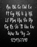 Handwritten brush style modern cursive font  on chalkboard background. Textured handletterered latin font letters and numbers Vector illustration stock vector Royalty Free Stock Photo