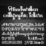 Handwritten calligraphic script Stock Photos