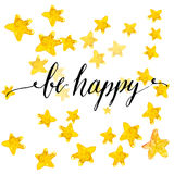 Handwritten calligraphy text be happy at yellow Stock Image