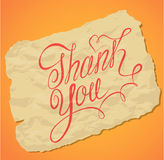 Handwritten calligraphy text Thank You over stock illustration