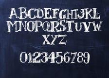 Handwritten chalk ABC. On a blackboard Stock Image