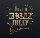 Handwritten Christmas slogan 'Have a holly jolly Christmas'. With golden effect royalty free illustration