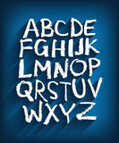 Handwritten English alphabet and a blue background Stock Photos