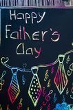 Handwritten Fathers day card with colorful letters. On dark paper stock images