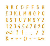 Handwritten font with punctuation marks. Handwritten bold gold font with punctuation marks on white background. Uppercase font contains question mark Royalty Free Stock Images