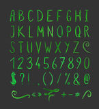 Handwritten font with punctuation marks. Hand drawn green watercolor font with punctuation marks on black background. Font contains question mark, exclamation Stock Image