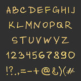 Handwritten gold alphabet. Shiny hipster font. Vector ABC letters Royalty Free Stock Image