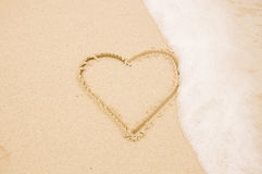 Handwritten heart on sand Stock Image