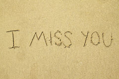 Handwritten i miss you on sand Stock Photos