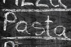 Handwritten inscription PASTA with chalk stock photo