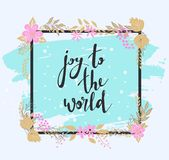Handwritten joy to the world text. Frame of flowers. Royalty Free Stock Photography