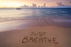 Free Handwritten Just Breathe On Sandy Beach Royalty Free Stock Photos - 176556488