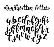 Handwritten latin calligraphy brush script of lowercase letters. Stock Photos