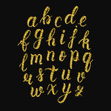 Handwritten latin calligraphy brush script of lowercase letters. Gold glitter alphabet. Vector Royalty Free Stock Images