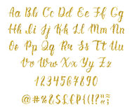 Handwritten latin calligraphy brush script with numbers and punctuation marks. Gold glitter alphabet. Vector Stock Photos