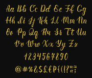 Handwritten latin calligraphy brush script with numbers and symbols. Gold glitter alphabet. Vector Stock Photos
