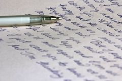 Handwritten Letter And Pen. A hand written letter with a silver ballpoint pen Royalty Free Stock Images