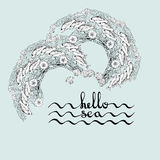 Handwritten lettering on a light blue marine background with fish. Hello Sea. Greeting card poster with calligraphy black text word. Hand drawn sea themed Stock Image