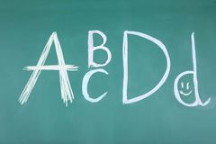 Letters ABCD. Handwritten letters ABCD on blackboard Royalty Free Stock Photos