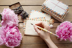 Handwritten letters and bouquet of pink peonies Royalty Free Stock Photo