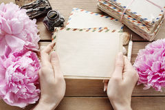 Handwritten letters and bouquet of pink peonies. Retro style stock image