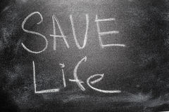 Handwritten message on chalkboard writing message Save Life Royalty Free Stock Photo