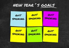 Handwritten 2019 New Year resolutions and goals in sticky notes in commitment determination about quit smoking giving up stock photo