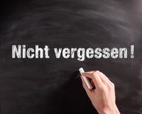 Handwritten Nicht Vergessen Phrase on Chalkboard Royalty Free Stock Photo