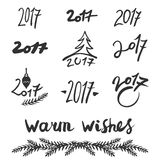 Handwritten 2017 numbers set on white background. And lettering: warm wishes. Vector illustration Royalty Free Stock Photography