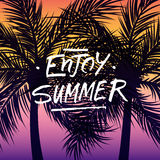 Handwritten phrase Enjoy Summer on summertime background with palm trees silhouette. Royalty Free Stock Photos