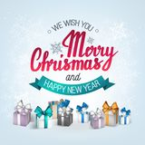 The handwritten phrase We wish you a Merry Christmas and happy New Year. The handwritten phrase We wish you a Merry Christmas and happy New Year on a white Royalty Free Stock Photo