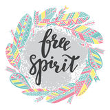Handwritten quote free spirit with feathers and arrows Stock Photo