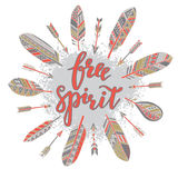 Handwritten quote free spirit with feathers and arrows Stock Photography